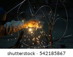 Closeup Worker Welding...