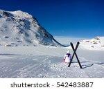 Girl And  Ski Equipment On The...
