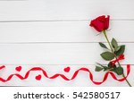 Red Rose On White Wooden...