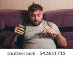 Small photo of Alcohol addicted man smoke cigarette