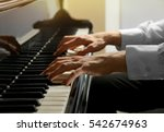Man Hands Playing Piano  Close...