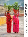 Small photo of AMBER, INDIA - NOVEMBER 13: Unidentified women walk with plants on their heads to Amber Fort on November 13, 2014 in Amber, India. Amber Fort is the main tourist attraction in the Jaipur area.
