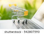 small shopping cart on laptop