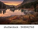pink sky and mirror like lake... | Shutterstock . vector #543042763