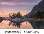 sunset mountain lake with pink... | Shutterstock . vector #543042847