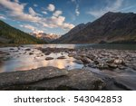 rocky lake surrounded with... | Shutterstock . vector #543042853