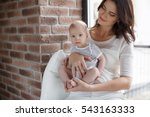 young mother holding her...   Shutterstock . vector #543163333