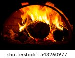 burning wooden logs in oven | Shutterstock . vector #543260977