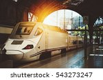 Small photo of Modern contemporary white train with acuminate face at the station of Barcelona, Spain, sunny summer day