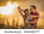 couple enjoying outdoors in a... | Shutterstock . vector #543430777
