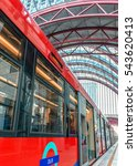 Small photo of LONDON, UNITED KINGDOM - SEPTEMBER 28, 2012: DLR Docklands Light Railway metro train arriving in London station on September 28. DLR is an automated system first opened in 1987 and serves Docklands.