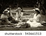 four young ladies eating ...