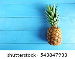 Ripe Pineapple On A Blue Woode...