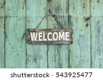Wood Welcome Sign Hanging By...