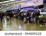 People Wait In Line For Flight...