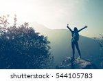 successful hiker open arms on... | Shutterstock . vector #544105783