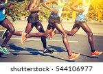 marathon runners running on... | Shutterstock . vector #544106977