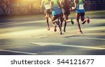 marathon runners running on... | Shutterstock . vector #544121677