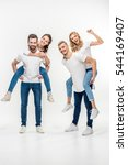 happy couples piggybacking and... | Shutterstock . vector #544169407