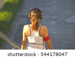 a sporty woman is jogging at... | Shutterstock . vector #544178047