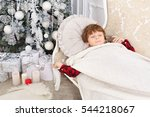 little boy sleeping under new... | Shutterstock . vector #544218067