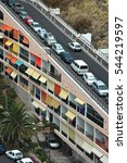 Small photo of TENERIFE, CANARY ISLANDS - JULY 31, 2005: Aerial view of a curious apartment building, built under the access road to the village of Mesa del Mar, on the coast of Tacoronte