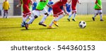 running young soccer football... | Shutterstock . vector #544360153