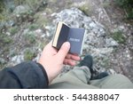 Small photo of Discover or Discovering new places idea. Traveler holds a book with the inscription.