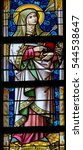 Small photo of GHENT, BELGIUM - DECEMBER 23, 2016: Stained Glass depicting Saint Teresa of Avila in the Cathedral of Saint Bavo in Ghent, Flanders, Belgium.