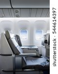 seat rows in an airplane cabin | Shutterstock . vector #544614397