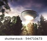 Ufo Hovering Over A Forest At...