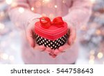 female hands holding a gift box ... | Shutterstock . vector #544758643