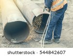Small photo of Welder worker cutting hole in metal with oxy acetylene blow torch at at building site. Vintage style.