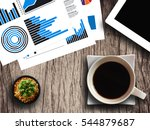 coffee cup   tablet and... | Shutterstock . vector #544879687
