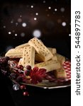 Small photo of Creatively styled and lit traditionally baked, all butter, festive Scottish short bread biscuits against a seasonal background with generous accommodation for copy space.