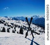 crossed skis standing in snow... | Shutterstock . vector #545030593