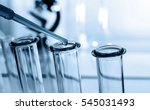 pipette adding fluid to one of... | Shutterstock . vector #545031493