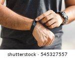 checking black wearable on... | Shutterstock . vector #545327557