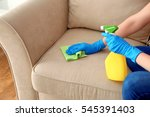 young woman cleaning sofa with... | Shutterstock . vector #545391403