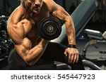 cropped shot of a strong... | Shutterstock . vector #545447923
