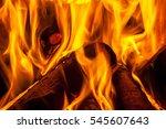 a fire burns in a fireplace. | Shutterstock . vector #545607643
