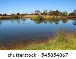 a lake or dam in a rural... | Shutterstock . vector #545854867