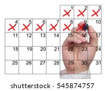 Hand Crosses Off Days In Red...