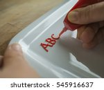 alphabet with red color paint  | Shutterstock . vector #545916637