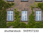 three window on the old brick... | Shutterstock . vector #545957233