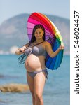 Pregnant Woman In Bikini Posin...