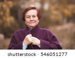 smiling senior woman wearing... | Shutterstock . vector #546051277