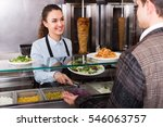 friendly young female worker...   Shutterstock . vector #546063757