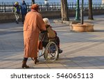 An Old Woman Pushes A...