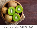 Kiwi Fruit On Wooden Backgroun...